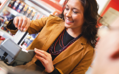 Happy shopper making a purchase with an eftpos gift card